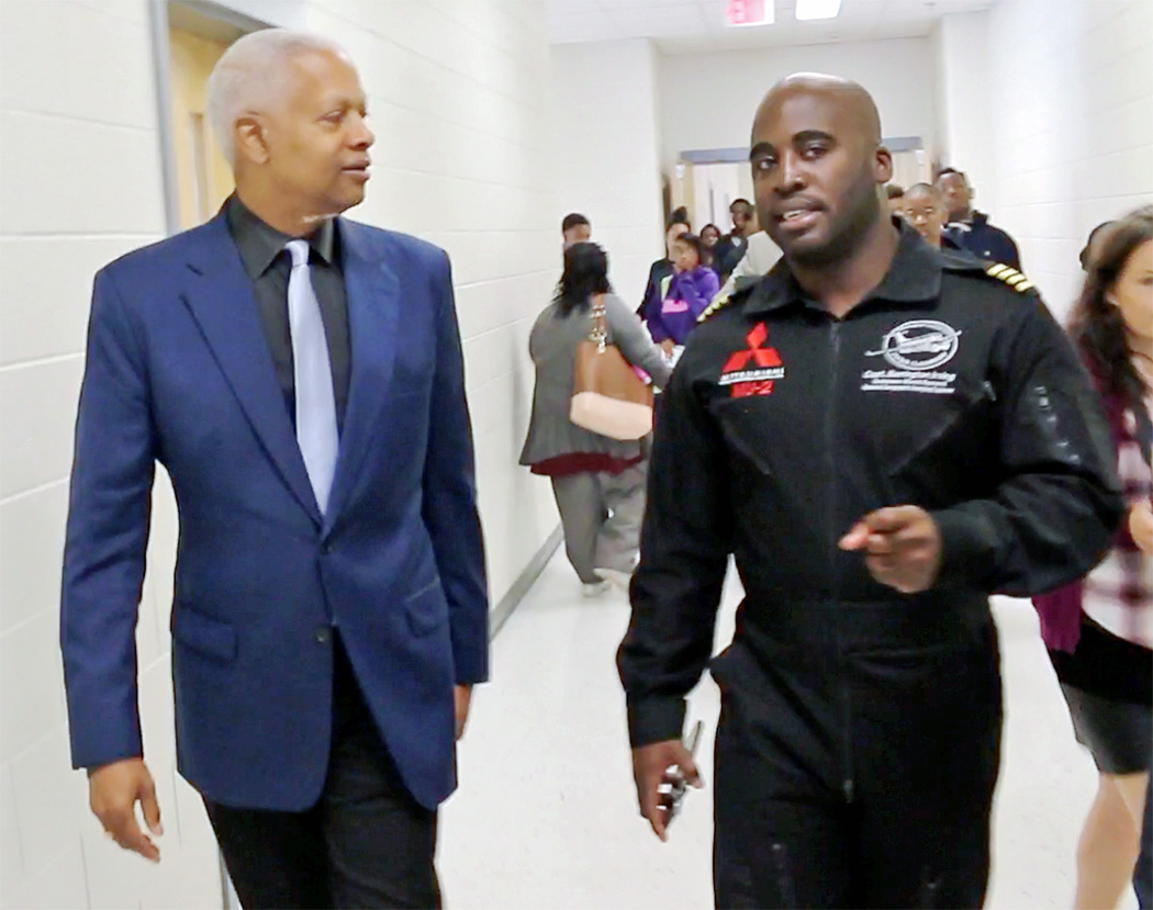 Congressman Johnson speaks with pilot Barrington Irving during their visit to MLK Jr. HS in DeKalb County, GA in October 2017.