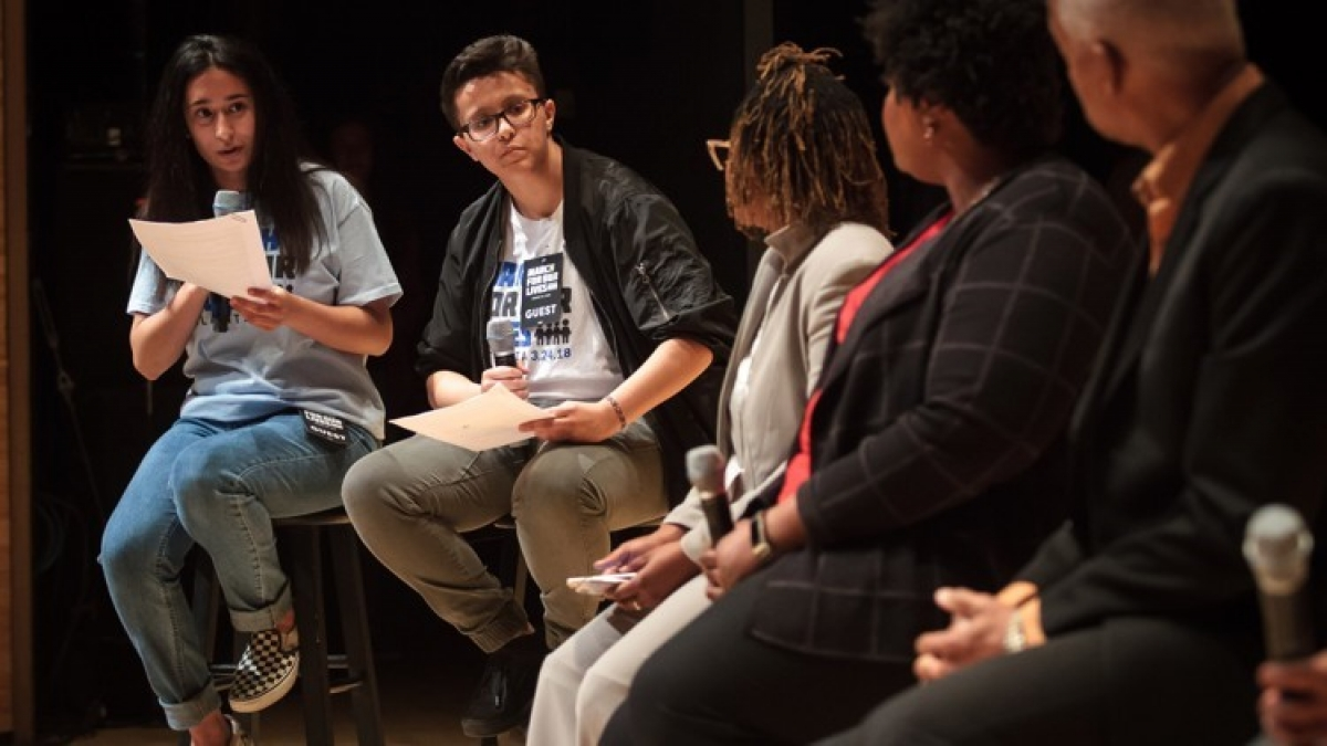 High school students Anam Hussain (left) and Joey Lopez direct questions to a panel of speakers during the Town Hall For Our Lives at the Rialto Center for the Arts in Atlanta on Saturday, April 7, 2018. STEVE SCHAEFER / SPECIAL TO THE AJC