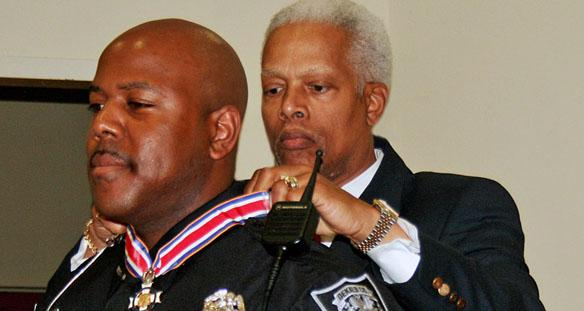 Rep. Johnson presents Congressional Badge of Bravery to DeKalb Officer feature image