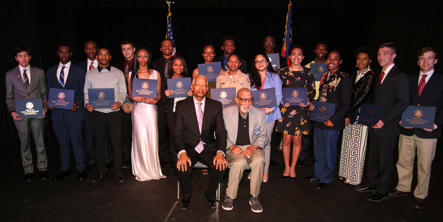 "Congressman Henry ""Hank"" Johnson and Tuskegee Airmen Val Archer (center) join 2019 U.S. Service Academy nominees for a picture on February 4 at the ART Station in Stone Mountain."