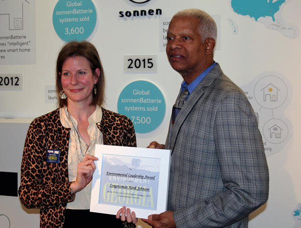 Rep. Hank Johnson receives recognition from Jennette Gayer of Environment Georgia for his 100% voting record on clean-energy and the environment in 2017.